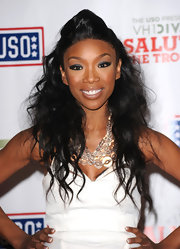 At the VH1 Divas Salute the Troops event, Brandy wore her hair in long, causal waves and twisted the front section up and back to add some oomph.