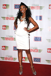 Brandy punctuated her white hot look with snakeskin platform peep-toe pumps.