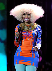 Nicki rocked out on stage at VH1's Diva Salute the Troops show. The rapper sported a blond Afro in a unique sculpted shape.