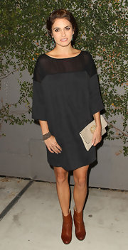 Nikki Reed stepped out at the 'Just Dance 3' launch party in a black shift dress with sheer shoulders and 3/4 length sleeves.