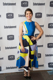 America Ferrera added an extra pop of color with a blue hard-case clutch by Vince Camuto.