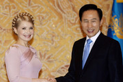 Ukraine's Prime Minister Yulia Tymoshenko shakes hands with South Korea's President Lee Myung-bak at presidential house on July 16, 2009 in Seoul, South Korea. Ukraine and South Korea met to discuss economic exchanges and to strengthen bilateral relationships in trade, culture and diplomacy.