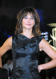 Sophie Marceau's metallic eyeshadow added shimmer and shine to her printed structured dress.