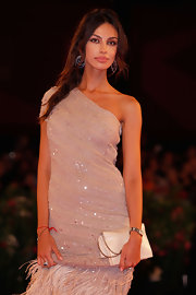 Madalina Ghenea carried an elegant clutch to match her dress at the Venice film fest.