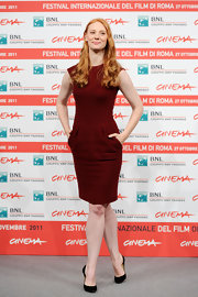 Deborah Ann Woll wore a burnt red cocktail dress with pockets for the 'Un Giorno Questo Dolore Ti Sara Utili' in Italy.