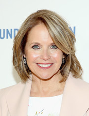 Katie Couric attended the New York premiere of 'Under the Gun' wearing her usual bob.