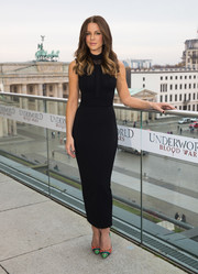 Kate Beckinsale spiced up her black dress with brightly hued Louboutin pumps.