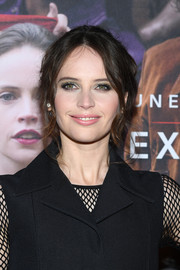 Felicity Jones sported a sexy messy updo at the Paris premiere of 'On the Basis of Sex.'