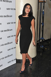 Leila Bekhti avoided the obvious choice of black on black, instead pairing her LBD with a pair of navy peep-toes.