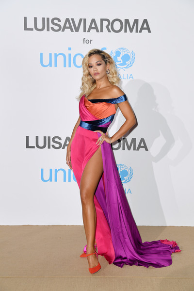 Rita Ora added more color with a pair of red Sophia Webster pumps.