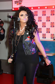 Jesy Nelson jazzed up her all-black outfit with a Union Jack vest.