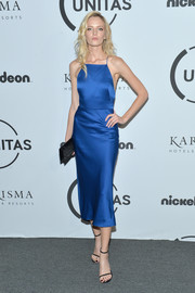 Daria Strokous was sleek and elegant in a royal-blue silk cocktail dress at the Unitas Gala Against Human Trafficking.