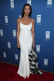 Padma Lakshmi exuded sultry glamour in a slinky white slip dress at the UNDP Inaugural Global Goals Gala.