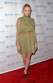 Lily Cole went for a demure look with this high-neck olive-green dress at the 2012 United Nations Every Woman Every Child Dinner.