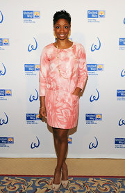 Montego Glover looked stylish and sophisticated in this peach tie-dye shift dress at the Women's Leadership Council event.