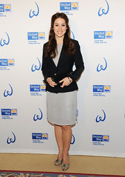 Chilina Kennedy looked sharp at the Women's Leadership Council event in this black blazer and glittering dress.