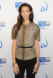 Olivia Chantecaille added edge to her look at the Women's Leadership Council event in this leopard blouse.