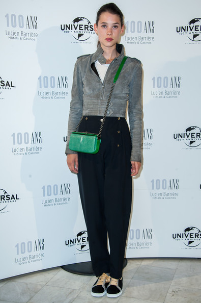 Astrid Berges Frisbey chose a pair of nautical-inspired slacks to team with her jacket.
