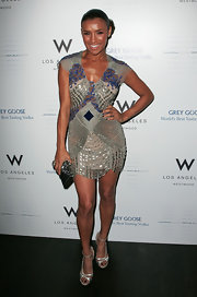 Melody wore a slinky beaded cocktail dress with strappy metallic sandals and a chignon-style updo.
