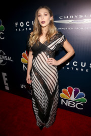 Elizabeth Olsen looked subtly sexy in semi-sheer lace and stripes during the Universal Golden Globes after-party.