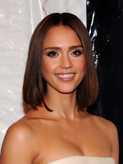 Jessica Alba highlighted her glowing makeup with polished center part locks.