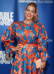 Busy Philipps teamed a nude hard-case clutch with a vibrant print dress for the 'Unbreakable Kimmy Schmidt' FYC event.