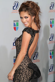 Anahi kept her her dress' sexy cutout back on full display by sweeping her warm brown tresses up into a messily curled updo.