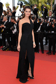 Isabeli Fontana kept it classic in a structured black one-shoulder gown by Brandon Maxwell at the Cannes premiere of 'The Unknown Girl.'