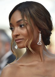 Jourdan Dunn complemented her updo with a dazzling pair of Atelier Swarovski earrings.