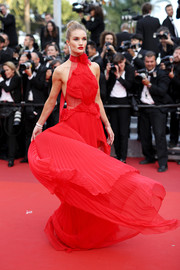 Rosie Huntington-Whiteley was sweet and glam in a red halter gown by Alexandre Vauthier Couture at the Cannes premiere of 'The Unknown Girl.'