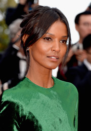 Liya Kebede rocked a messy center-parted updo at the Cannes premiere of 'The Unknown Girl.'