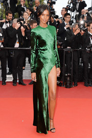 Liya Kebede was all about simple sophistication in an emerald-green velvet gown with a thigh-high slit at the Cannes premiere of 'The Unknown Girl.'