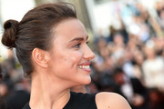 Irina Shayk attended the Cannes premiere of 'The Unknown Girl' wearing her hair in a twisted bun.