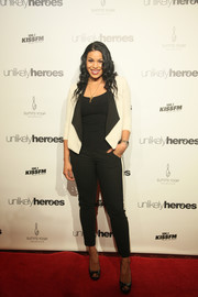 Jordin Sparks coordinated her jacket with a pair of black-and-white side-striped pants by Vince.
