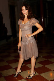 Violante Placido looked stunning in a Fall 2010/11 dress, while attending the 'L'Uomo Vogue' party in Venice.