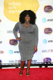 Danielle Brooks worked her curves in a gray sweater dress with a lace-up neckline and choker detail at the 2018 AmplifiED Gala.