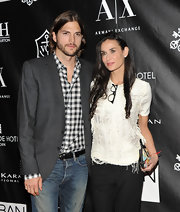 Demi Moore posed with Ashton at the Urban Zen Awards in a white tee with a artfully frayed bodice.