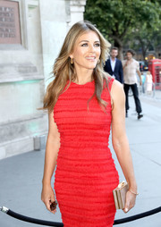 Elizabeth Hurley hit the V&A summer party sporting a gold box clutch and red dress combo.