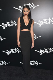 Chanel Iman put her supermodel figure on show in a plunging black cutout gown during the grand opening of Vandal.