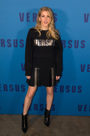 Ellie Goulding kept it youthful and edgy in a black Versus Versace logo sweatshirt layered over a pleated-hem dress during the brand's fashion show.