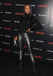 Brandy paired her sequined pants with a black hard case clutch with sparkled embellishments.