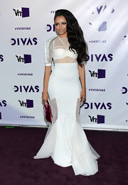 Kat Graham made mermaid gowns funky with this white design featuring sheer mesh panels.
