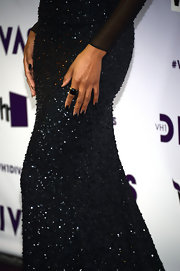 Ciara walked the red carpet at VH1 Divas 2012 wearing a black and gold cocktail ring.