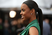 Kelly Rowland make her sleek pony look super-high-fashion with a sharp side part and wrap-around base.