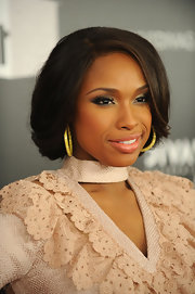 Jennifer Hudson wore her hair in a romantic bobby pinned updo at VH1 Divas Celebrates Soul.
