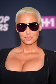 Amber Rose accessorized with a pair of rimless aviators for that extra-cool factor.