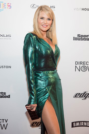 Christie Brinkley attended the VIBES by Sports Illustrated Swimsuit 2017 launch carrying a black box clutch with gold trim.