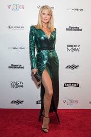 Christie Brinkley stole the spotlight in a metallic-green tuxedo gown with a thigh-high slit at the VIBES by Sports Illustrated Swimsuit 2017 launch.