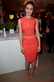 Emmy Rossum worked the cutout trend so elegantly in this pearl-accented red dress during the VIP sneak peek of go90.