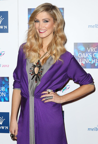 Delta Goodrem was perfectly styled at the VRC Oaks Club luncheon with this gemstone statement necklace and purple dress combo.